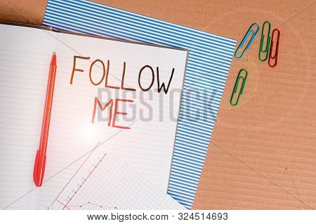 Writing note showing Follow Me. Business photo showcasing Inviting a demonstrating or group to obey your prefered leadership Striped paperboard notebook cardboard office study supplies chart paper. poster