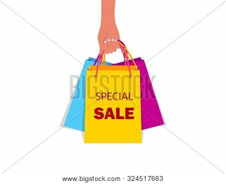 Hand Holding Paper Bag For Shopping. Female Hand With Gift Bag From Shop, Store In Flat Style. Buyer