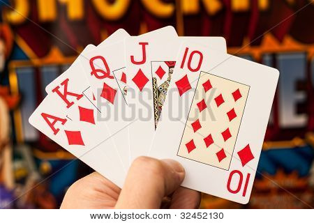 Royal flush cards holding
