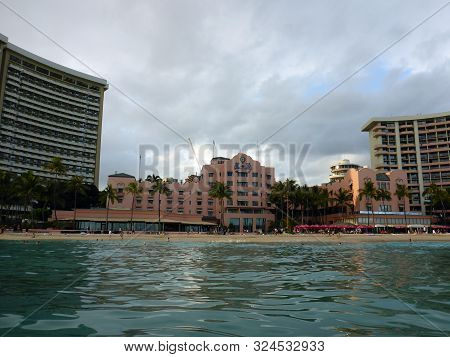 Waikiki - September 10, 2017: The Royal Hawaiian Hotel And People On The Beach Seen From Ocean Off W