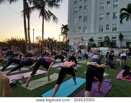 Waikiki - September 19, 2017: Large Group Of People Do Humble Warrior Yoga Pose At Vino And Vinyasa