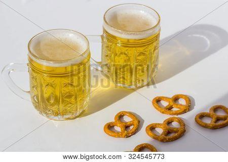 Octoberfest Concept. Beer Mug With Snacks Of Salt Pritzels, Bretzel On A White Background. Close Up