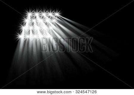 Searchlight Illuminates. Floodlights Illuminating The Stadium. Sports Event. Scene, Stage Light With