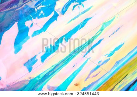 Real Hologram Background Of Wrinkled Abstract Foil Texture With Multiple Colors. Holographic Iridesc