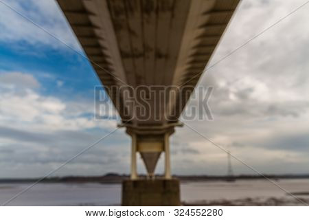 Underside Of Large Road Suspension Bridge, Landscape.