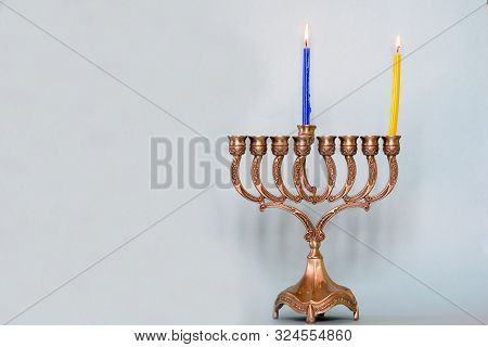 First Day Of Hanukkah With Burning Hanukkah Colorful Candles In Menorah Traditional Candelabra .chan