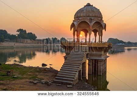 Gadisar Lake In The Morning At Sunrise. Man-made Water Reservoir With Temples In Jaisalmer. Rajastha
