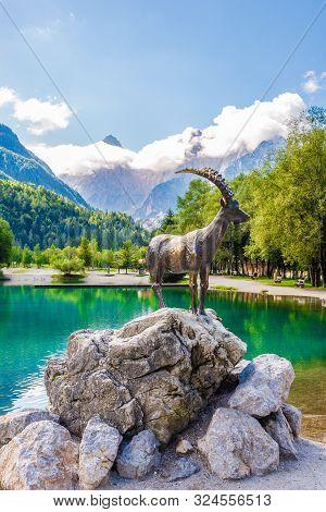 Kranjska Gora,slovenia - September 3,2019 - View At The Jasna Lake With Capricorn Statue Near Kranjs