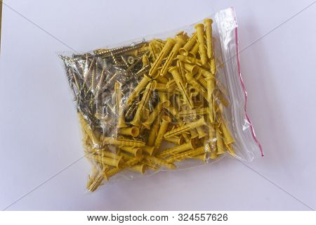 Screws With Wall Plugs. Dowel. Wall Anchors. Pack With Screws And Dowels For Wall Repair.