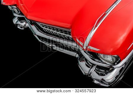 Front View Of A Classic American Retro Car. Clearly Visible Is The Shiny Chrome And The Large Headli