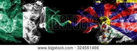Nigeria Vs Tibet, Tibetan Abstract Smoky Mystic Flags Placed Side By Side. Thick Colored Silky Smoke