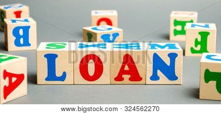 Wooden Blocks With The Word Loan. Consumer, Banking And Property Loan. Business And Entrepreneurial