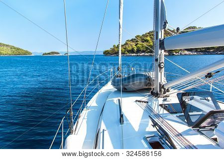 Sailing Boat Near Croatian Island Lastovo. View From The Deck Of The Yacht. Vacation On A Boat. Sail