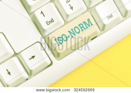 Handwriting text Iso Norm. Concept meaning An accepted standard or a way of doing things most showing agreed White pc keyboard with empty note paper above white background key copy space. poster
