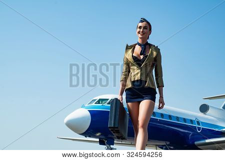 Stewardess. Journey And Jet Trip. Woman And Commercial Plane. Portrait Of Charming Stewardess Wearin