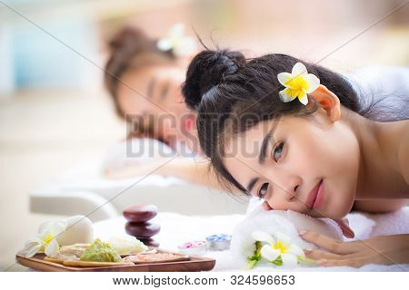 Two Young Asian Women Relaxing In Spa Salon. Beauty Service With Friends On Spa Bed. Ladies Relax Wi