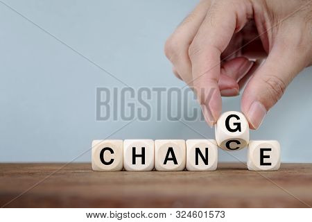 Hand Changing Word From Change  To Change On Wooden Cube