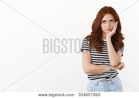 Ignorant Indifferent Redhead Teenage Girl In Striped T-shirt Rolling Eyes Up Bothered And Annoyed Wi