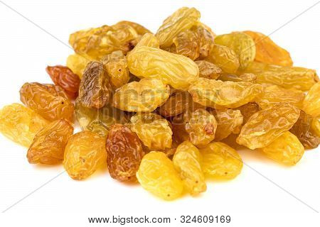 Heap Of Dilicious Sun-dried Jumbo Golden Raisins On White Plate Closed-up