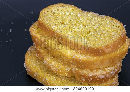 Delicious Crisp Sliced Butter Toast On Black Plate
