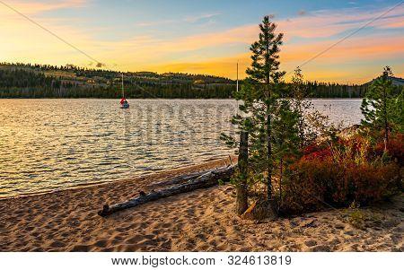 The Sun Sets In Early Fall On Redfish Lake, Sawtooth Nra, Idaho, Usa