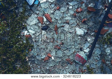 Shards Of Smashed Roof Tiles And Glass Covering The Floor