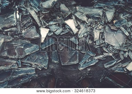 Pieces Of Glass Sticking To A Scorched Surface