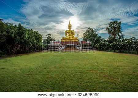 poster of The big golden Buddha statue on hill, Phuket, Thailand. Beautiful golden Buddha inside the temple of popular and largest Bid Buddha in Chalong, Phuket, Thailand. Peace and meditation concept