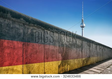 The Berlin Wall With Tv Tower Against A Blue Sky