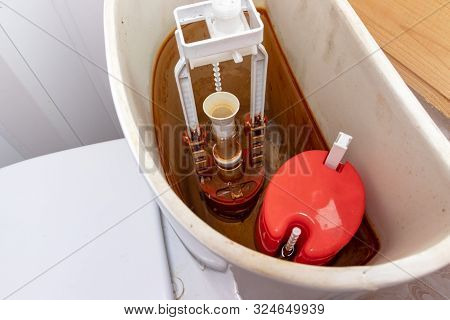 Dirty Unhygienic Rusty And Calcified Flush Tank Of Toilet With Limescale And Rust Stains And Scum Ne