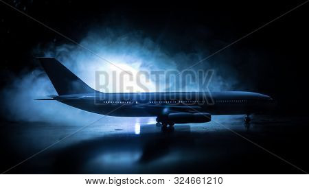 Artwork Decoration. White Passenger Plane Ready To Taking Off From Airport Runway. Silhouette Of Air