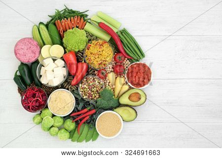Vegan food for healthy diet with foods high in protein, vitamins, minerals, anthocyanins, antioxidants, smart carbs and dietary fibre. Cruelty free food concept. Flat lay.