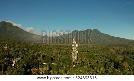 Telecommunication Tower, Communication Antenna Against Mountains And Rainforest, Aerial View. Repeat
