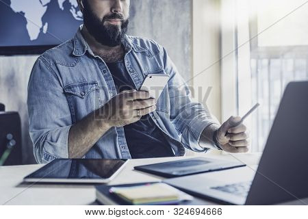Corporate Employee Working At Desktop Using Digital Devices And Gadgets. Serious Man Busy At Workpla