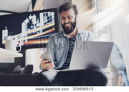 Smiling Young Man Reading Text Message On His Smartphone. Social Media User Communicating Online. Be