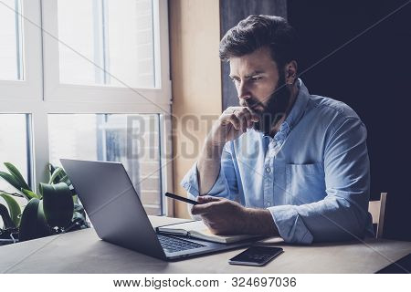Professional Sitting In Office In Front Of Laptop. Developer Thinking On Solutions For Work. Home-ba