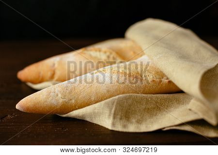 Freshly Baked Baguette. Two Freshly Baked Baguette Wrapped In A Bakery. Bakery Products
