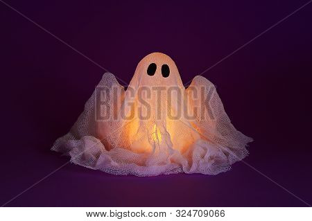 Halloween Ghost Of Starch And Gauze On Ultraviolet Background. Gift Idea, Decor Halloween. Process K