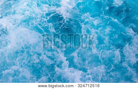 Sea Surface Texture. Blue Water Wave Photo. Blue Sea Water Mesh. Motor Boat Trail On Blue Ocean Surf