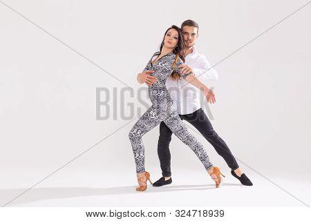 Young Couple Dancing Latin Dance Bachata, Merengue, Salsa, Kizomba. Two Elegance Pose Over White Bac
