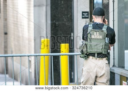 New York City, 9/27/2019: Us Marshal Is Talking On The Phone.