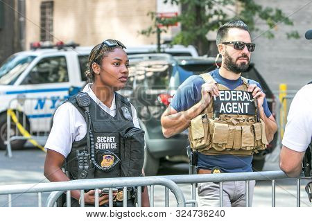 New York City, 9/27/2019: Government Agents Stand Behind A Barricade In The Streets Of Manhattan.