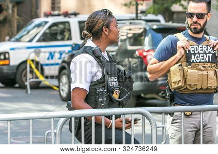 New York City, 9/27/2019: Female Secret Service Agent And A Federal Agent Are Having A Friendly Conv
