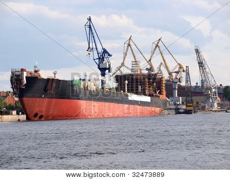 Color photo of a ship in port