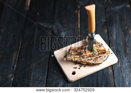 A Sharp Knife Permeates A Piece Of Fried Meat, Juicy Grilled Steak, Aromatic Spices.
