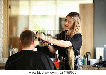 Blonde Hairdresser Shaving Man By Electric Razor. Woman Hairstylist Using Shaver And Hairbrush For S