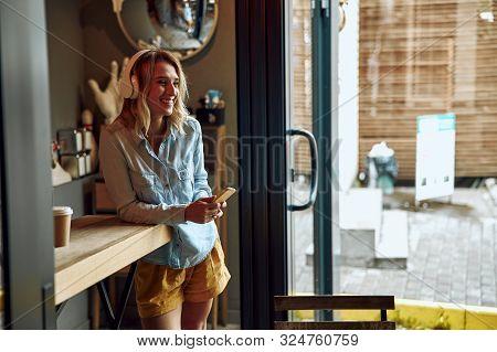 Woman Listening To Music In Headphones Stock Photo