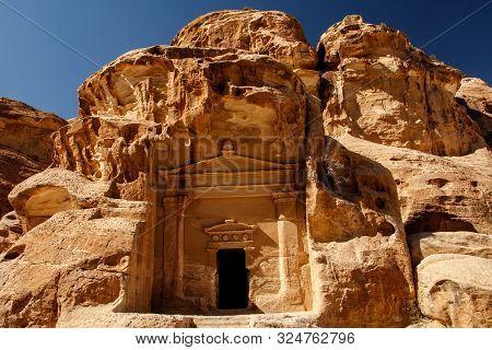 Ancient nabataean house in city of Petra near Wadi Musa in Jordan poster