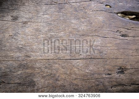 Grey Wooden Texture Photo. Timber Board With Weathered Crack Flat Lay. Rustic Wooden Table Top View.