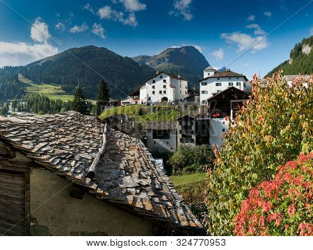 Picturesque Mountain Village With White Stone Houses And Stone Roofs And Fall Color Foliage